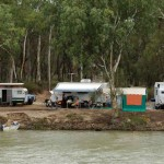 Free campers along the Victorian side of the Murray River below the Abbotsford Bridge