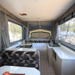 cozy bed and dinette in Goldstream RV Gold Storm RL Vacationer 3