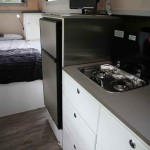 kitchen sink and storage cabinets
