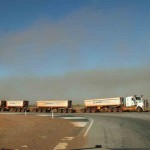 A long road train in dust near Port Hedland - Pilbara, WA