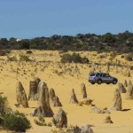 The coastal terrain north of Perth consists of white sandhills, limestone outcrops and low heathland shrubs.