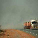 Road train coming through bush fire smoke - near Port Hedland, WA