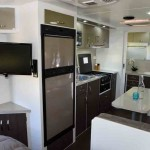 The kitchen and dinette dominate the centre of the van.