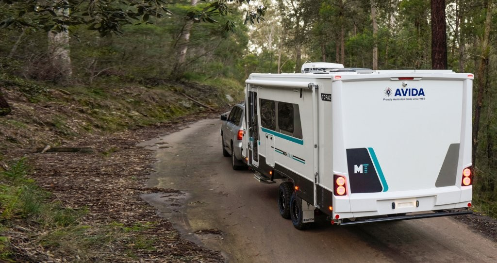 This is a photo of the CV 7052SL Topaz caravan wandering down a dirt road. What is around the bend?