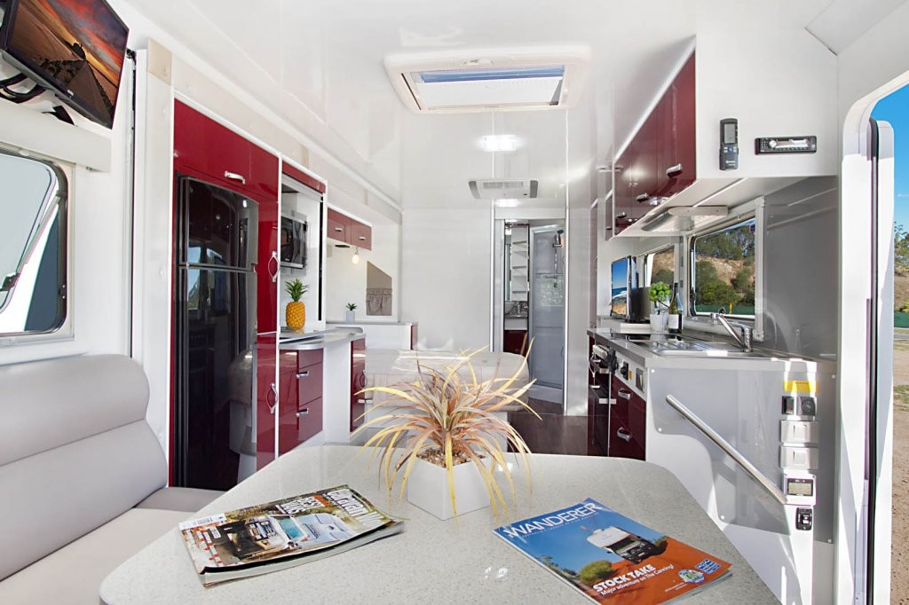 The CV7652SL Topaz caravan is a dream to tow and also very pleasing on the eyes. There's plenty of storage inside and out, and all of the features to make you feel at home. This Topaz caravan has been optioned with Ruby Super Gloss panels, Amaretto Stone benchtops, Steel coloured splashbacks and Chestnut Glaze UL upholstery.