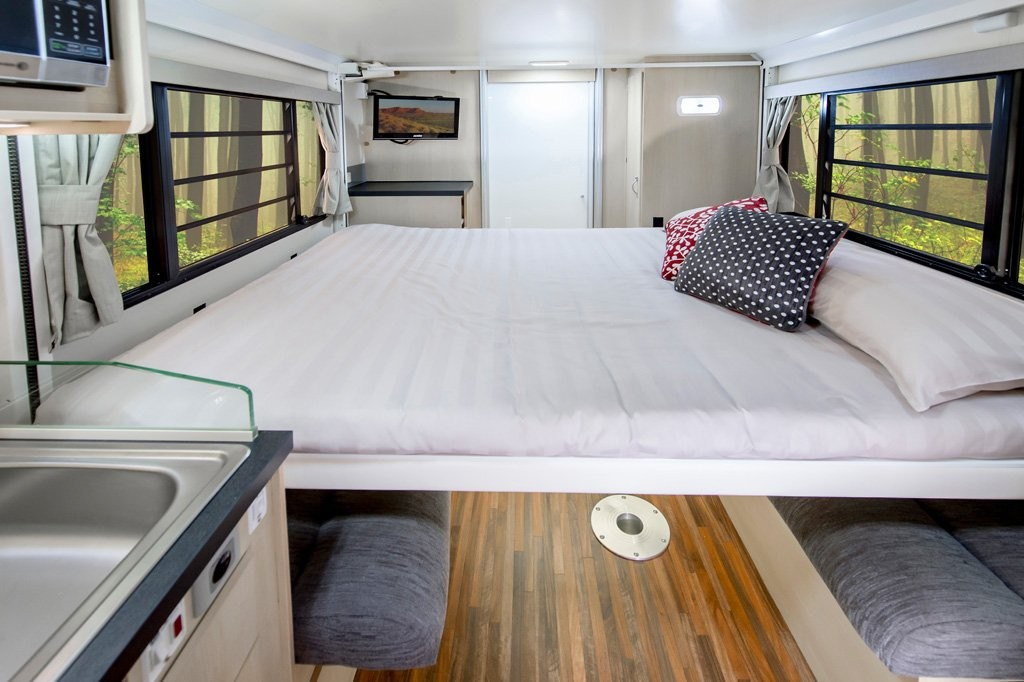 The electric roll down bed comes down from the ceiling at the push of a button, and goes back up just as easily when you're up during the day enjoying the living area of your B6712 Leura motorhome.