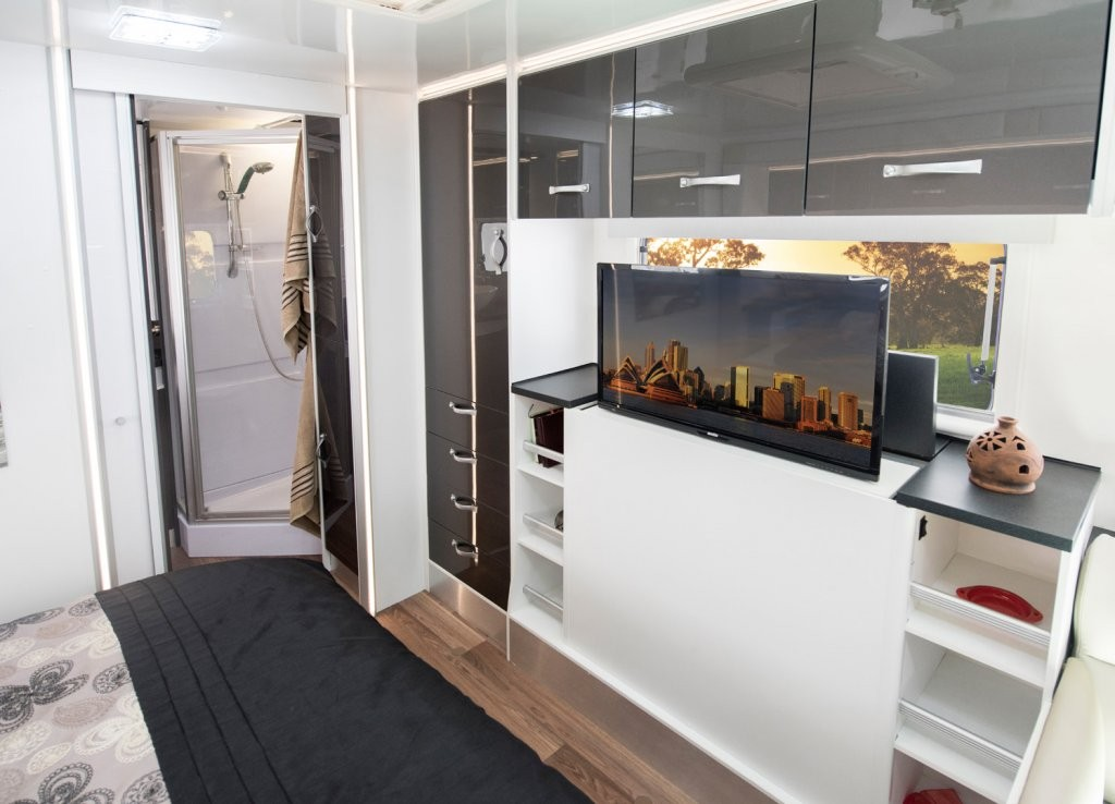The CV7052SL Topaz caravan bedroom area has a television positioned at the foot of the bed for comfortable viewing whilst relaxing on the large bed.