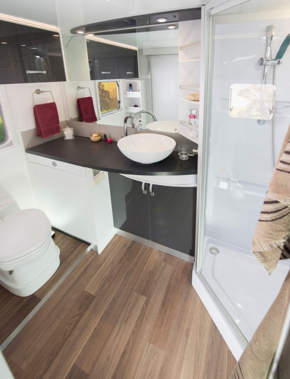 The CV7052SL Avida Topaz Caravan features a well equipped bathroom with shower, basin and toilet. There's also great storage space in the cupboards.