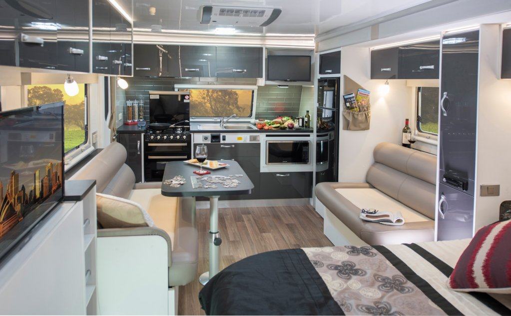 The kitchen is located to the front of the caravan in the CV7052SL Topaz caravan with the dining and lounge area fittingly positioned for a comfortable dining experience.
