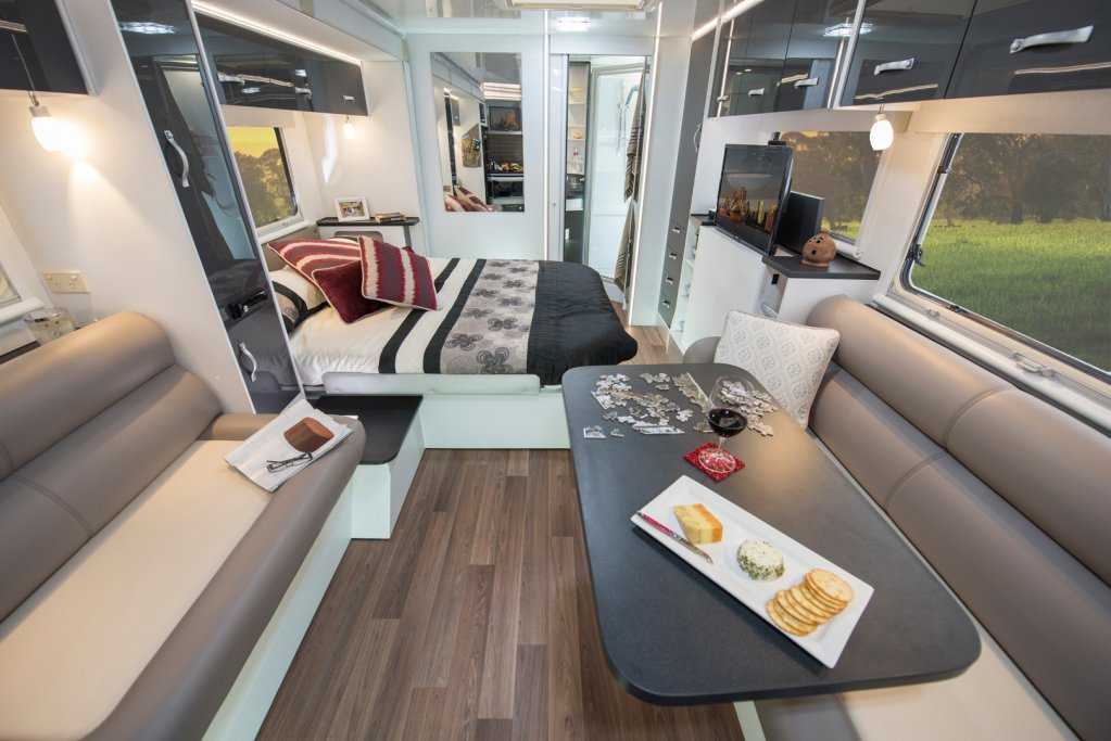 There is ample living area in the CV7052SL Topaz caravan with a central dining and bedroom area, and a rear bathroom. The kitchen in this model is located at the front of the caravan.