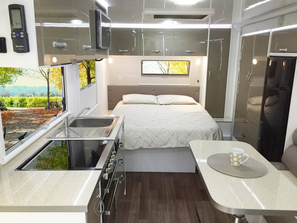Travel in luxury and style with your Topaz CV7084SL caravan. The lucky owner of this Topaz caravan above has opted for Amaretto Stone benchtops and Frappe Super Gloss colour cabinet doors. See all the colour options available to the Topaz caravan range.