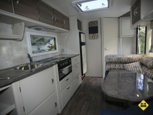 The living area has the familiar layout of the galley running along the driver side with diner opposite and the bed up front.