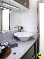 A Dometic ceramic toilet bowl, a designer ceramic sink