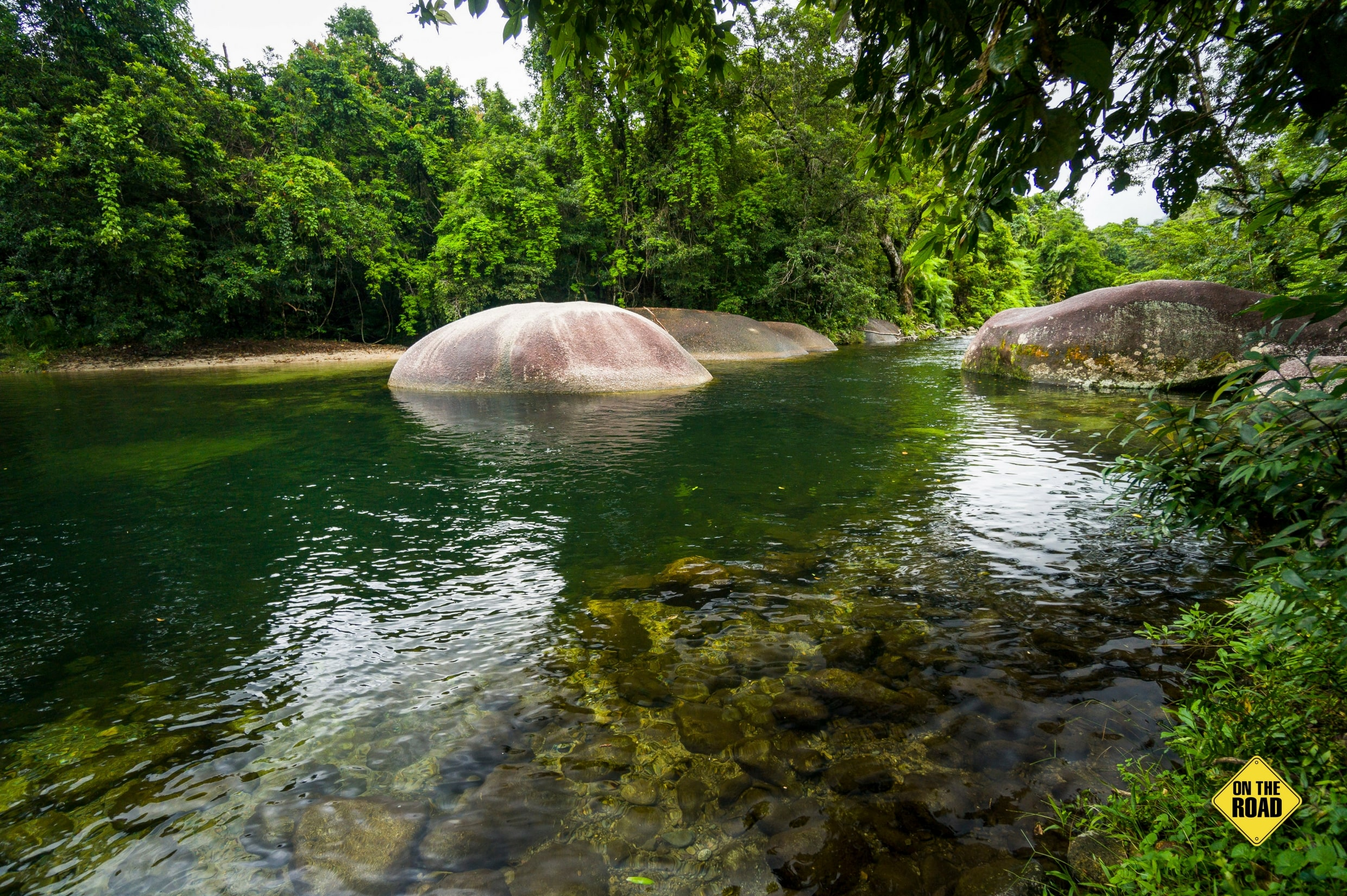 Enormous granite boulders slow the flow of Babinda Creek