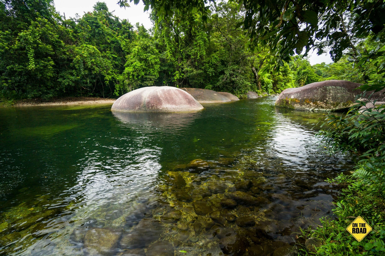 Enormous granite boulders slow the flow of Babinda Creek
