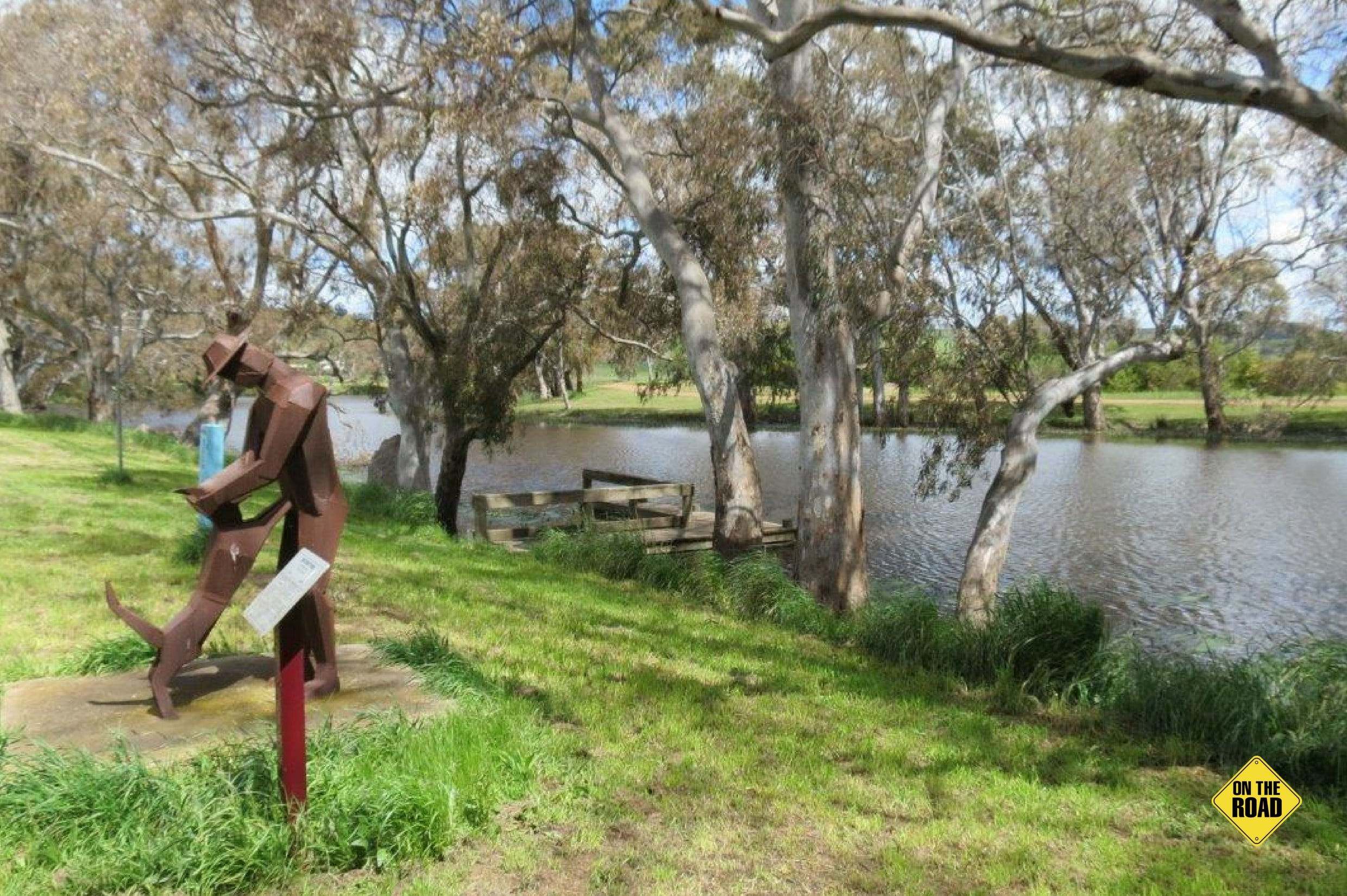 Ess Lagoon campsite with fishing landing and steel sculpture of man and kelpie