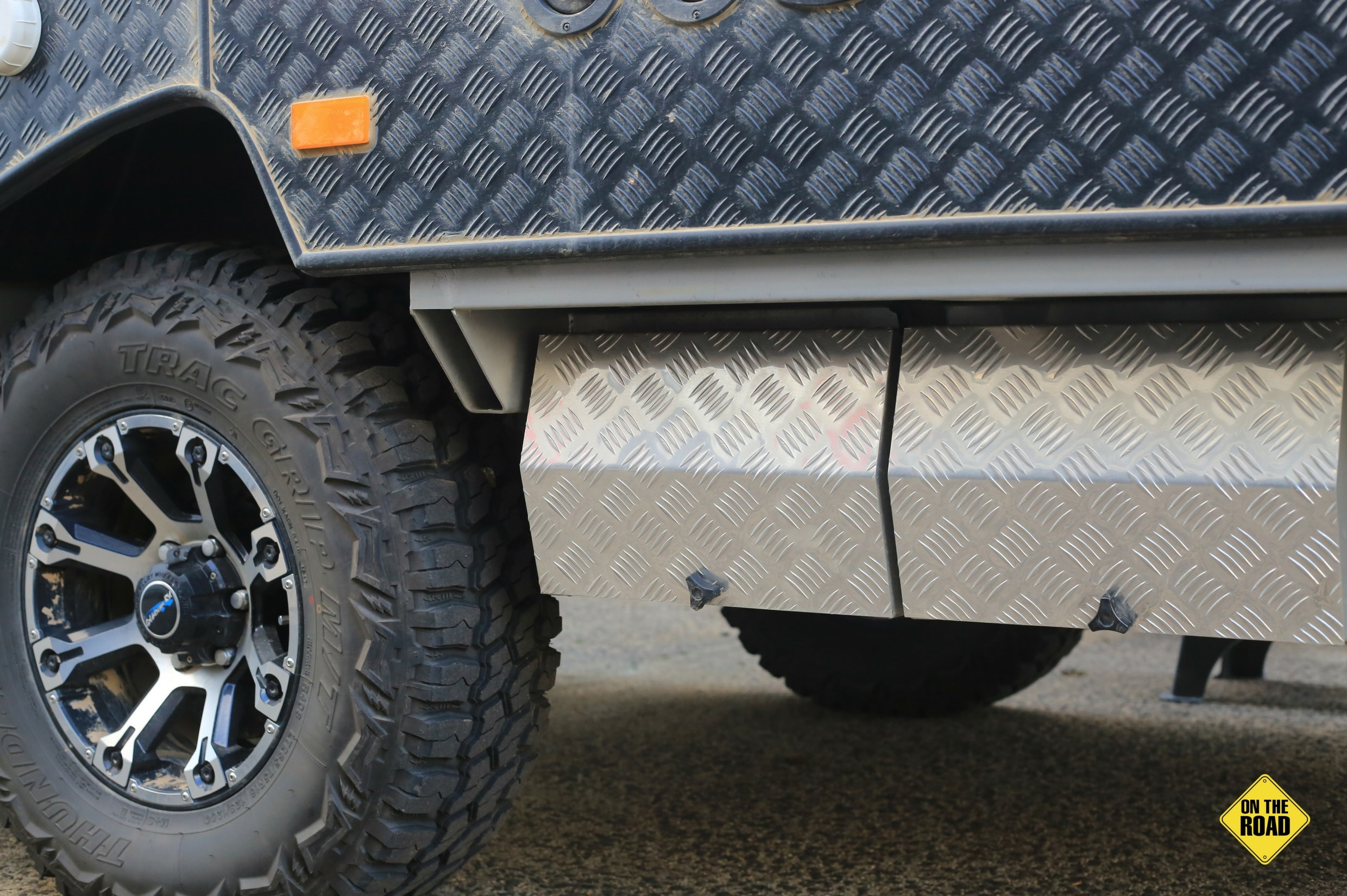 10b0d17852 Goldstream Wing 3 ST Camper on black checkerplate with chunky offroad tyres
