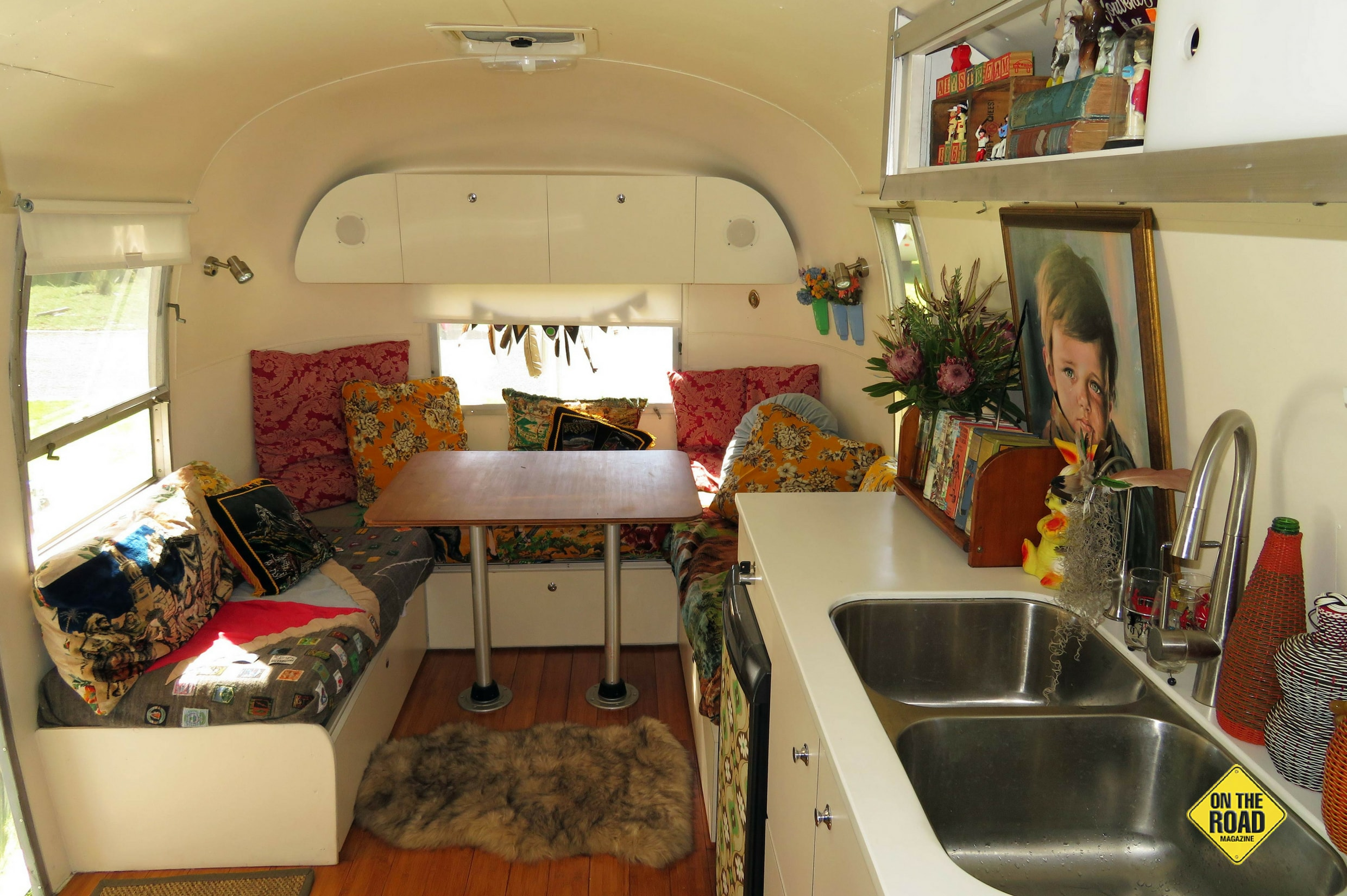 Looking towards the front of the spacious Airstream, with the lounge/dining area up front and kitchen in the middle