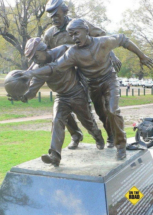 "Statue outside the MCG of Wills umpiring the 1858 game between Melbourne Grammar and Scotch College. The plaque reads that Wills ""did more than any other person (as a footballer and umpire, co-writer of the rules and promoter of the game) to develop Australian football during its first decade""."