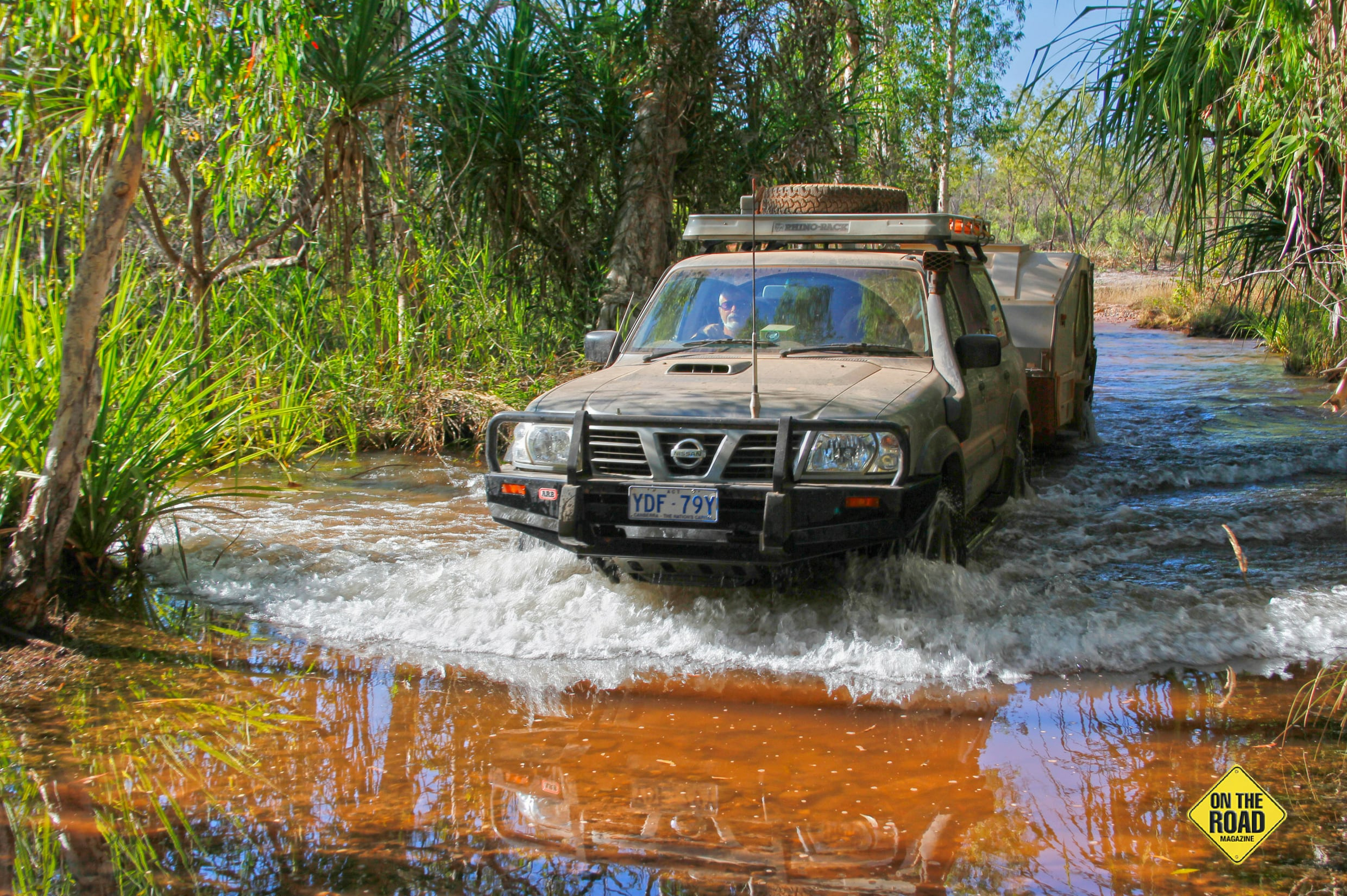 The Nissan hauling Tvan across the Reynolds River in Litchfield NP NT