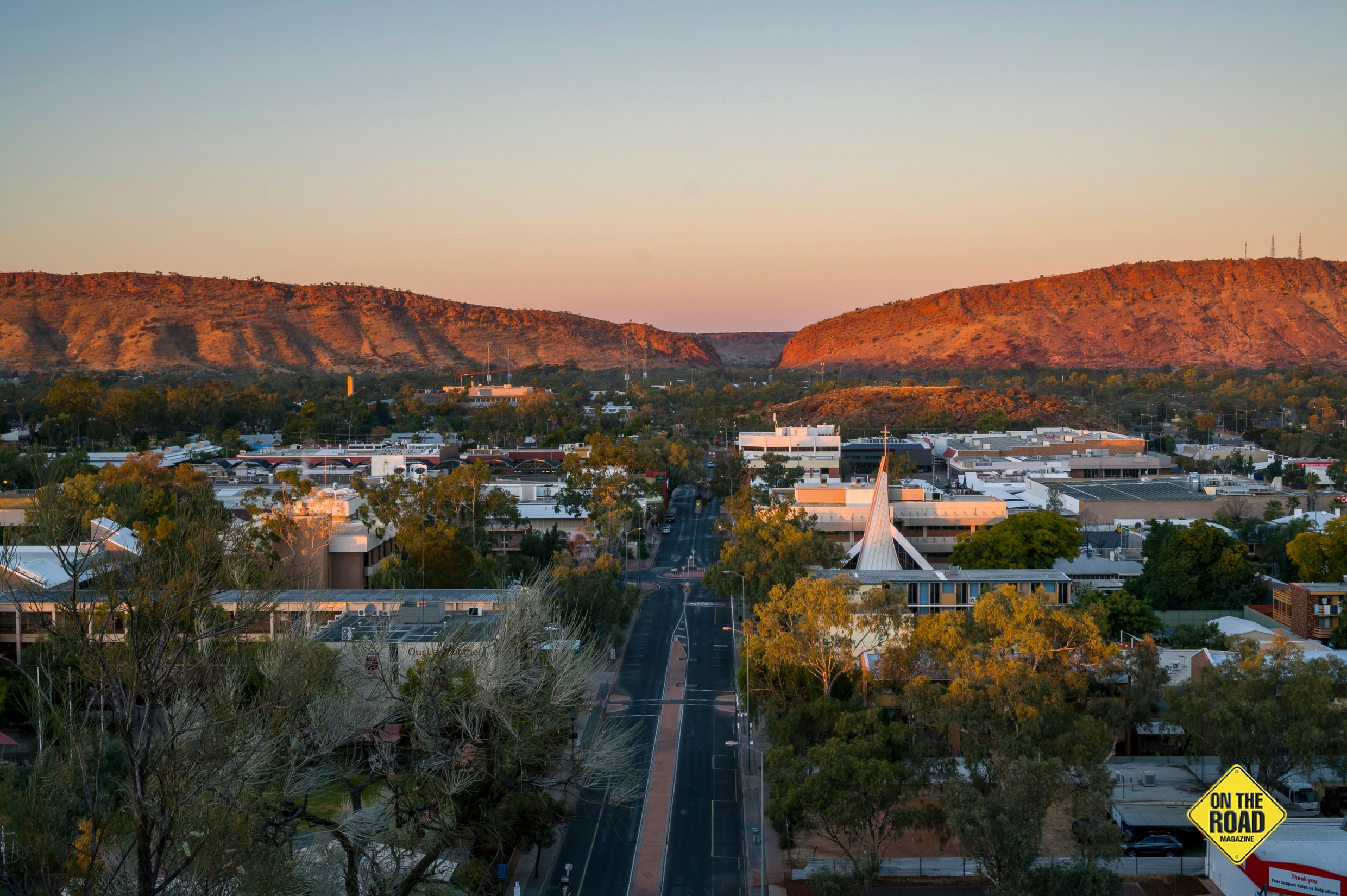 The grand MacDonnell Ranges rise either side of Alice Springs