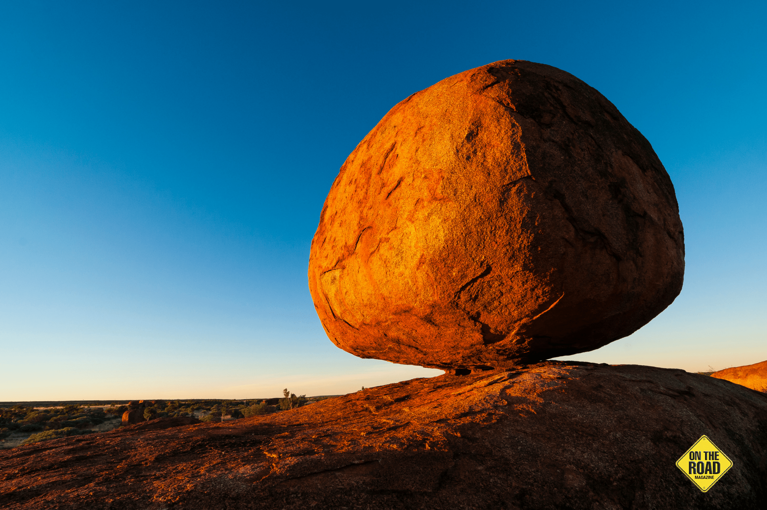 Precariously balanced orbs glow golden at Devils Marbles