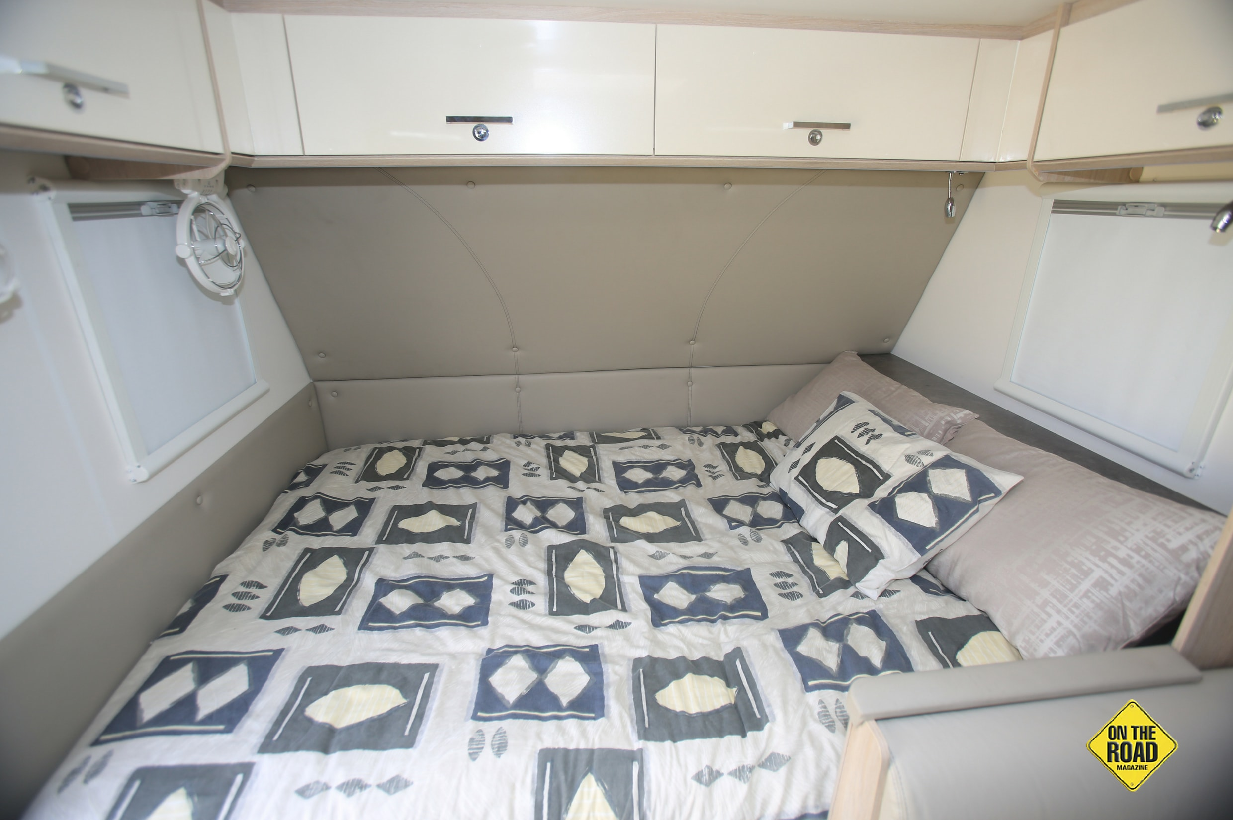 The bed runs east west across the front of the caravan.
