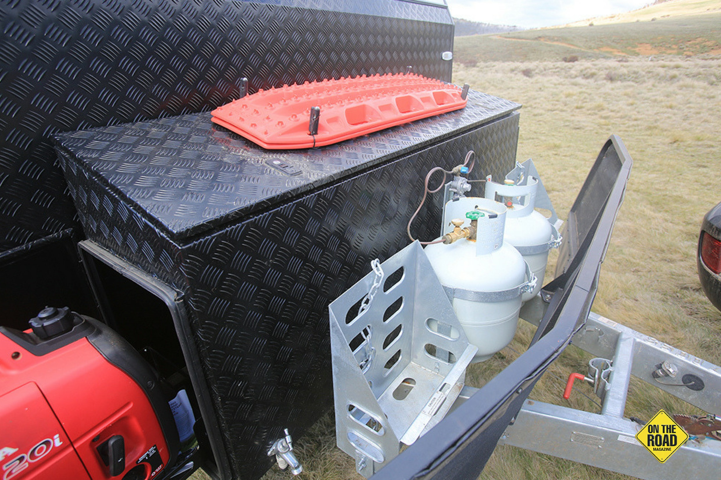 There is a very large front storage and twin gas bottles