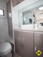 The bathroom has plenty of cupboards and an elegant finish.