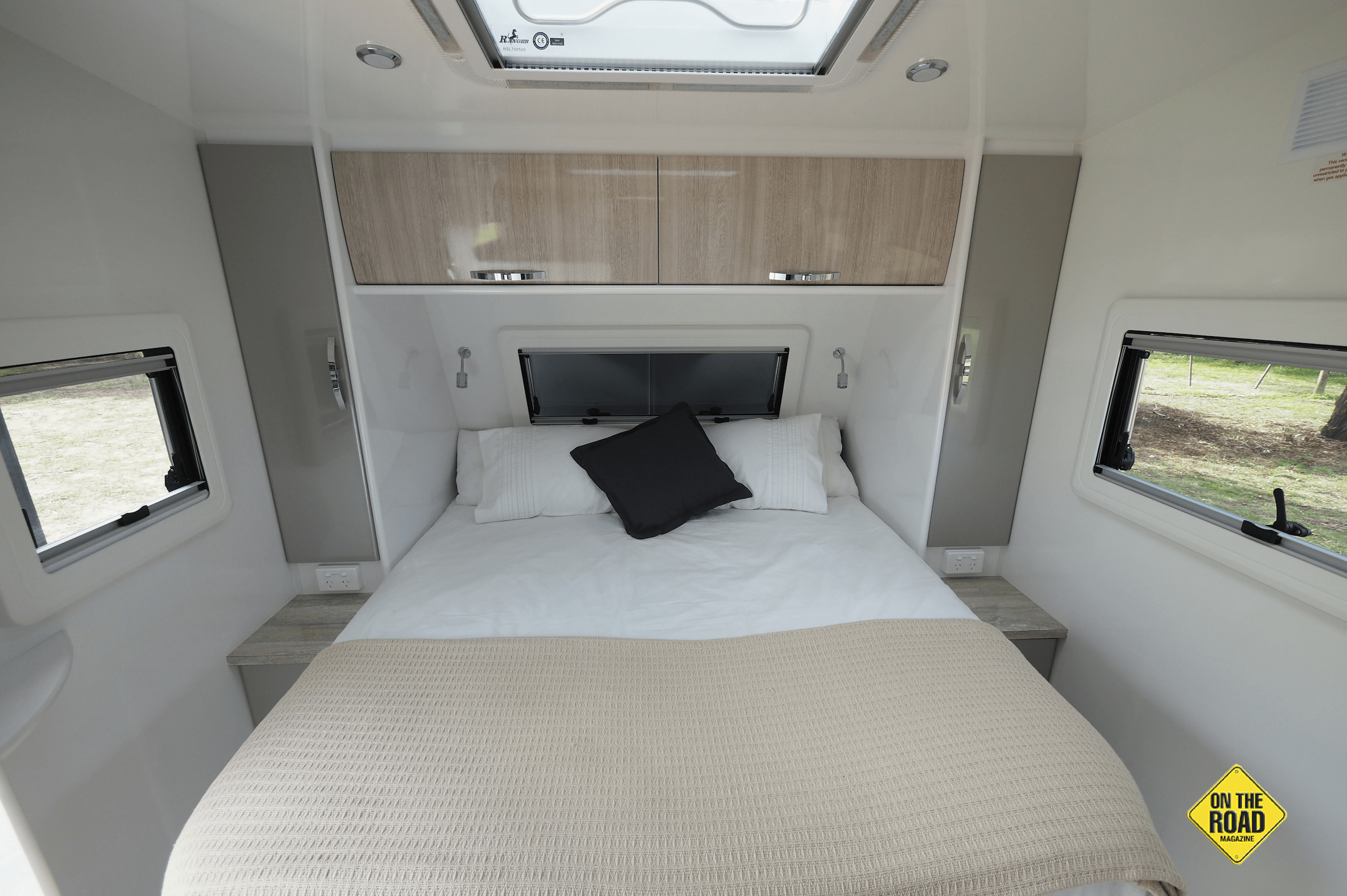 The queensize bed sits at the rear of the caravan.