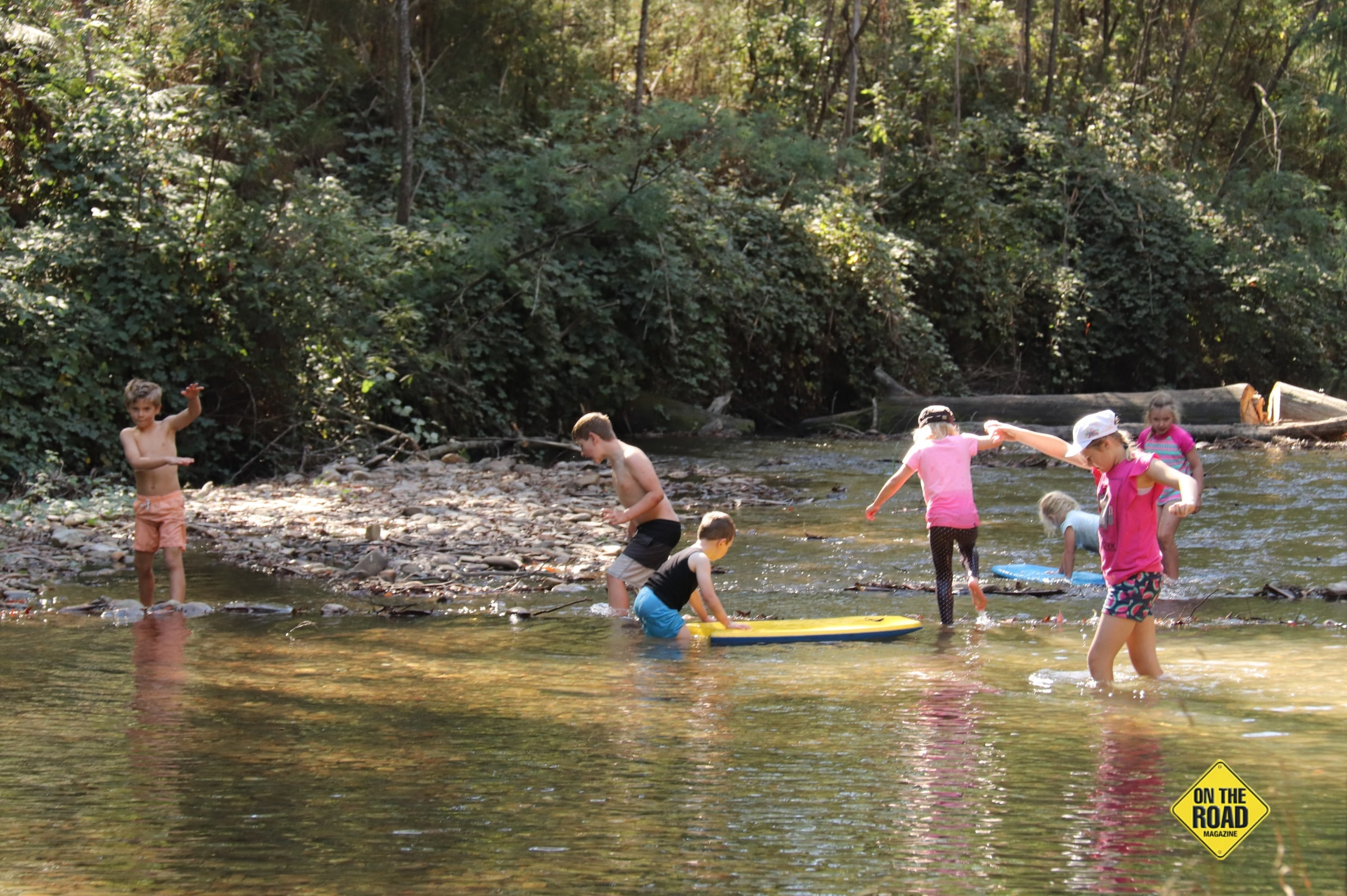 Kids swimming and playing at the creek in Knockwood Reserve