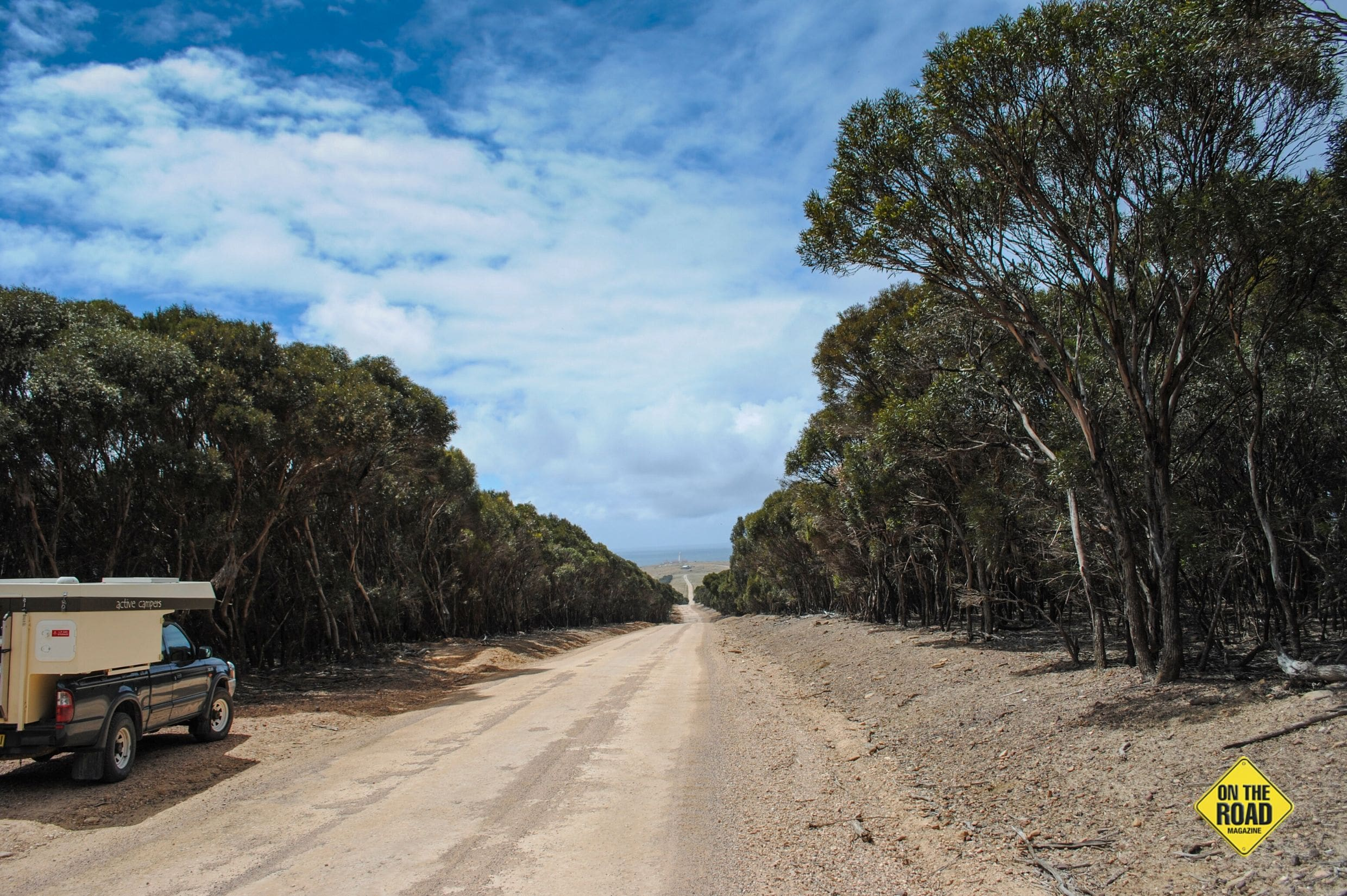 The road out to Cape Willoughby Lighthouse. The lighthouse can be seen in the distance