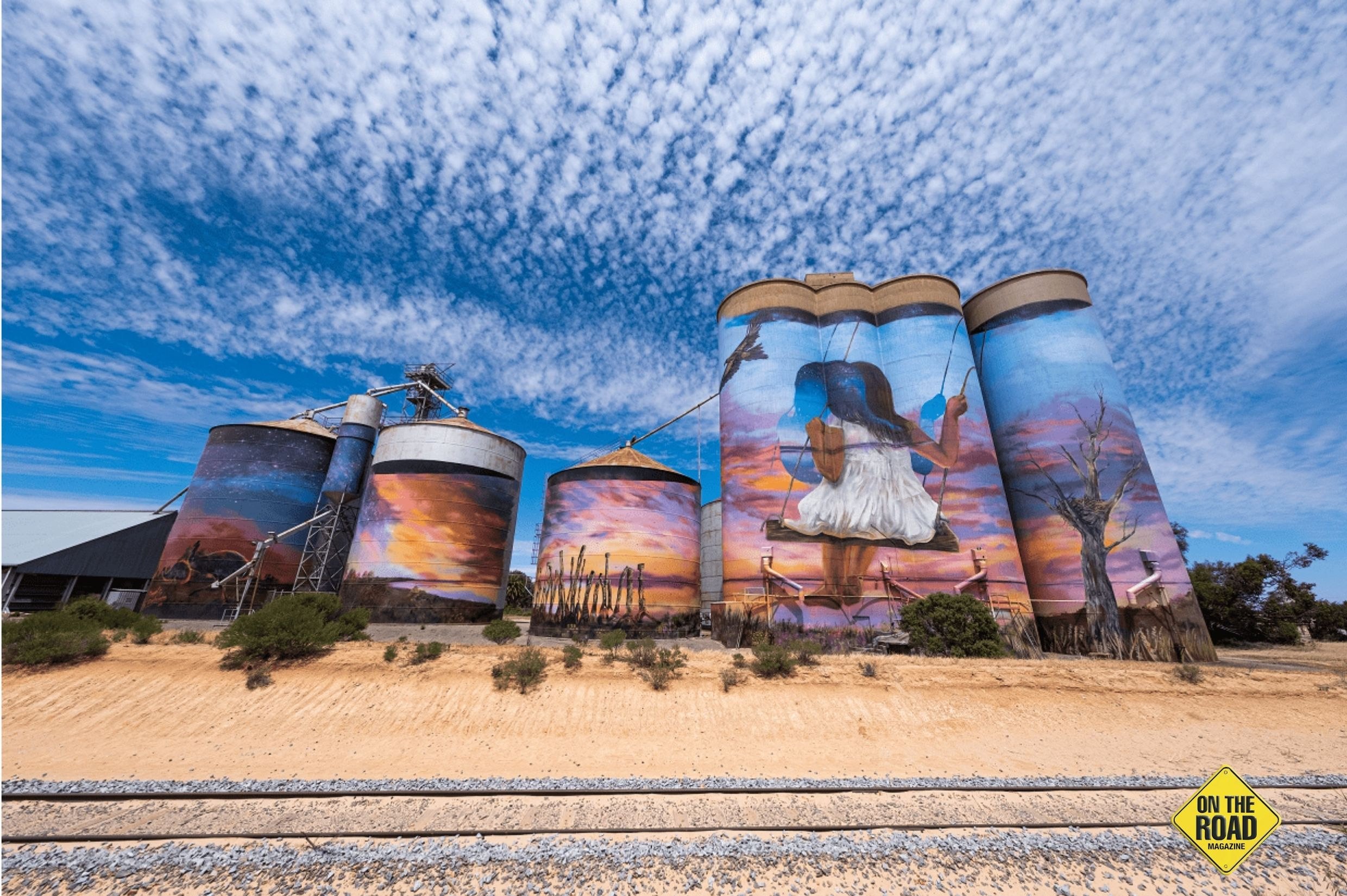 A brilliant cloud formation above Seal Lake's painted silos AC